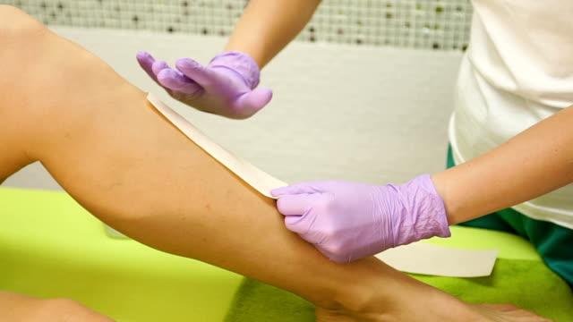 Woman leg waxing