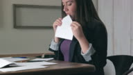 Woman Licks to Seal Envelope then Writes Address on Letter