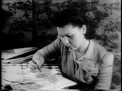Woman looking at ration book and making shopping list and comparing to book / empty counters and display cases at butcher shop