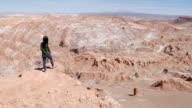 Woman looking at the Luna Valley in Atacama desert