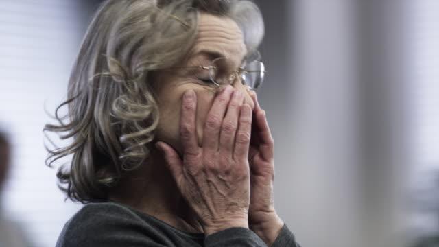 CU Woman looking tired, rubbing eyes / Payson, Utah, USA