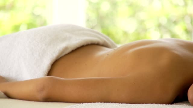 Woman lying down on massage table, relaxing