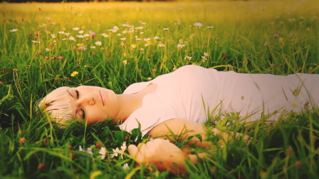 HD DOLLY: Woman Lying In Grass-Vintage Look