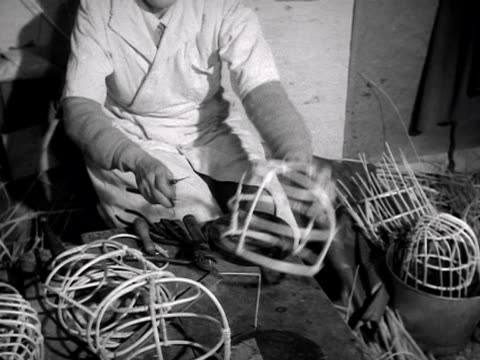 A woman makes the basket frames for bearskin caps for the Grenadier Guards