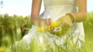 HD SLOW MOTION: Woman Making A Wreath Of Wildflowers