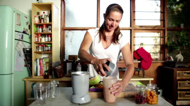 Woman Making Fruit Smoothie