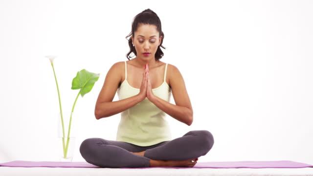 woman meditating on matt