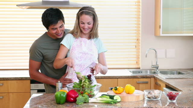 A woman mixing a salad