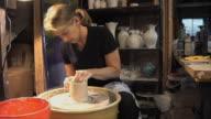 MS Woman molding clay on wheel / Naperville, Illinois, USA