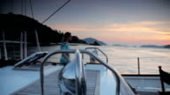 Woman on a Yacht at Sunrise, Sailing Holiday