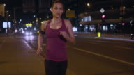 SLO MO TS Woman on an evening run through the city