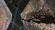 woman on an indoor climbing wall