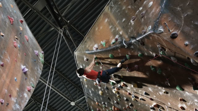 woman on an indoor climbing wall