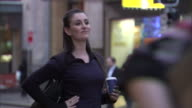 CU, SELECTIVE FOCUS, Woman on busy city street drinking coffee and waiting for cab, Sydney, Australia