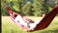Woman on hammock relaxing