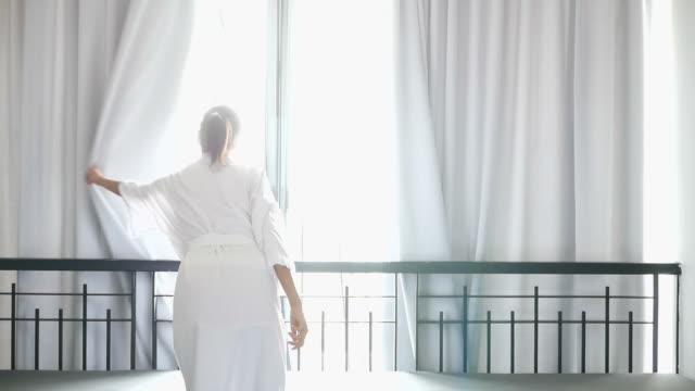 Woman open window in the morning