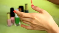 Woman Painting fingernail