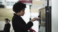 MS Woman paying at gas station / Orem, Utah, USA