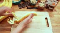 POV woman peeling two bananas