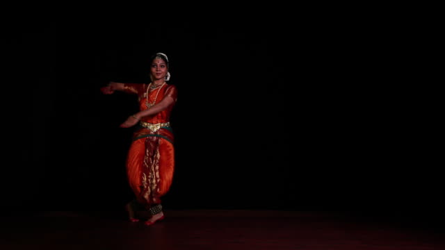 Woman performing bharatanatyam dance on the stage
