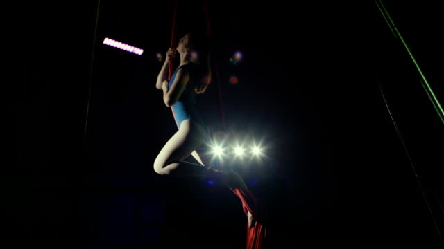 Woman performing on aerial silk