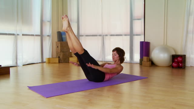 Woman performing pilate move on a mat