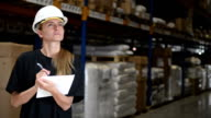 Woman performs control in warehouse
