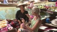 MS Woman photographing self with fruit seller on Damnoen Saduak floating market, Bangkok, Thailand