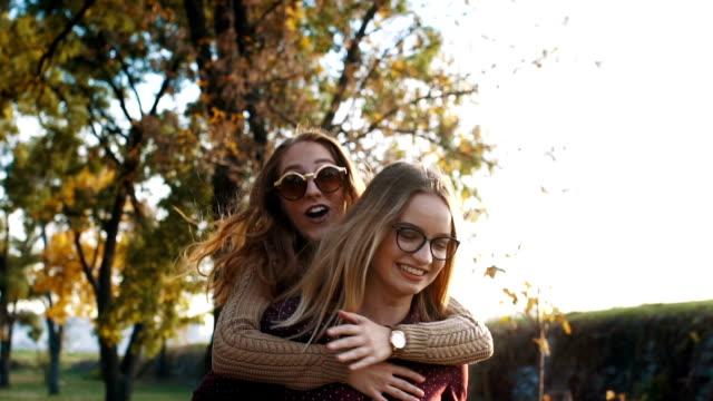 Woman piggyback her bestfriend