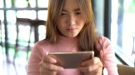 Woman play game on smart phone