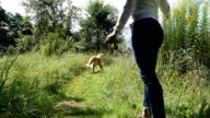 Woman playin with the dog.