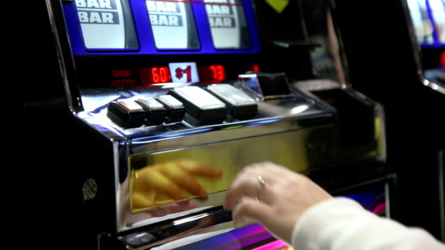 Woman Playing A $1 Slot Machine