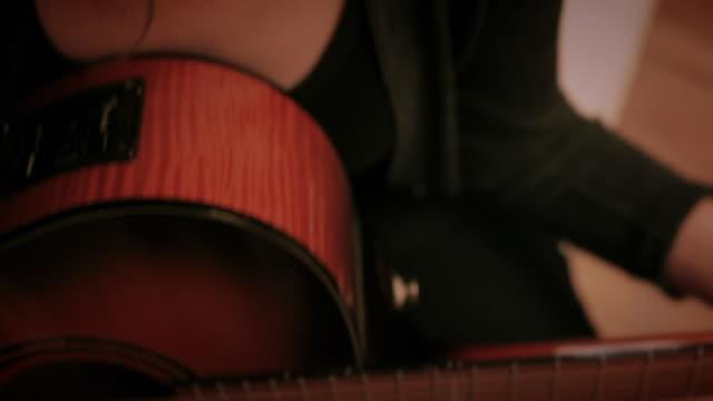 CU TD TU Woman playing acoustic guitar / New York City, New York, USA