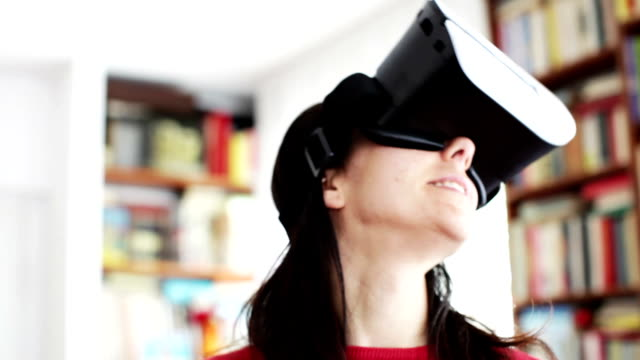 Woman playing at home with Virtual Reality Headset