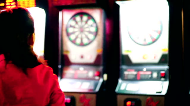 Woman playing darts.