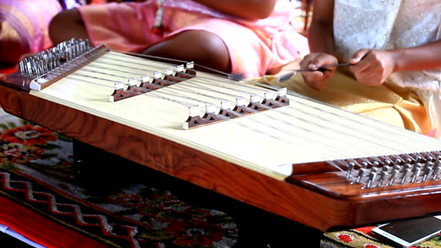 Woman Playing Thai Dulcime.