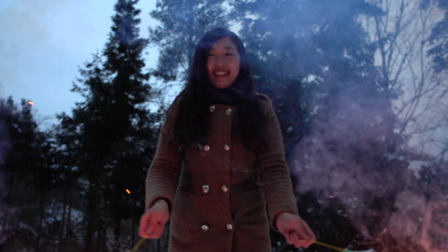 Woman playing with fireworks