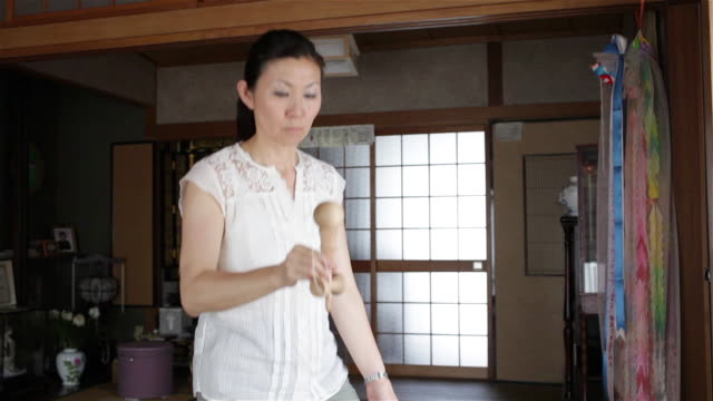 Woman playing with Kendama
