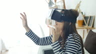 Woman Playing with Virtual Reality Headset at home, VR Glasses