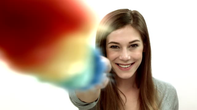 HD: Woman Pointing With Duster At Camera