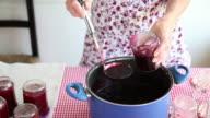 woman pourring homemade cherries jam, France, Ardeche