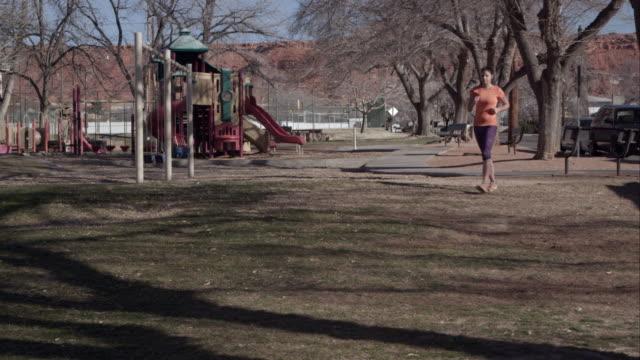 Woman power walking in the park.