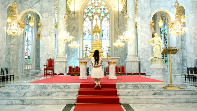 Woman Pray In A Beautiful Chruch
