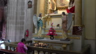 Woman praying in Metropolitan Cathedral in Mexico