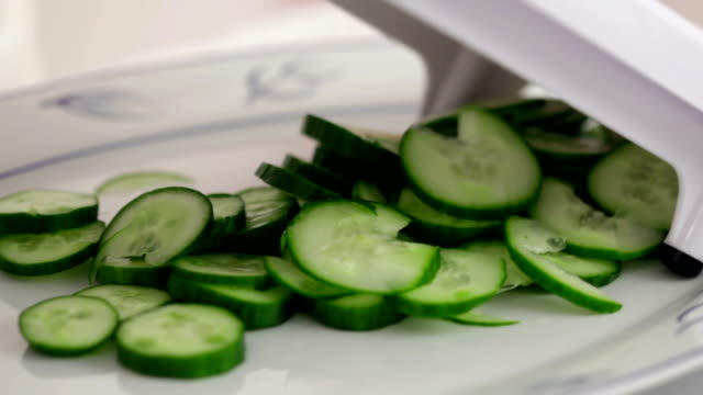 Woman prepares salad with the help of vegetable cutter