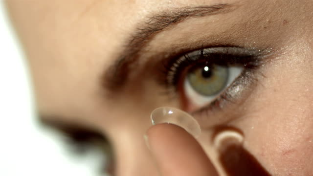 HD: Woman Preparing To Insert Contact Lens