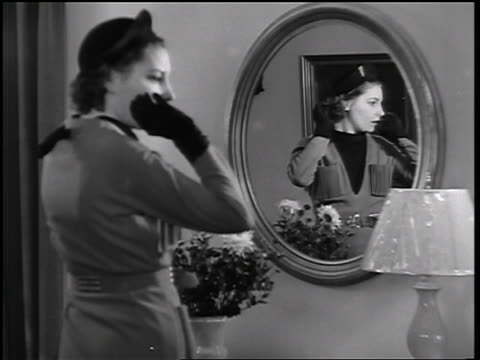 B/W 1935 woman primping in mirror  turning + talking to someone off screen / educational