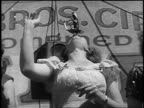 B/W 1946 woman pulling sword out of mouth at carnival side show