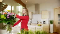 Woman puts out flowers
