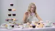 Woman putting sugar in tea